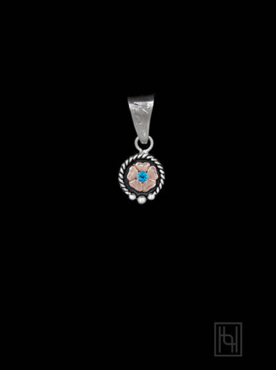 Engraved Flower Pendant with Blue Topaz